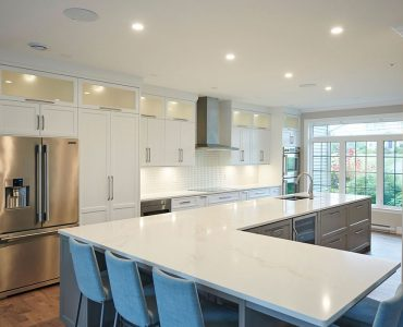 Photo of transitional style kitchen with white cabinets